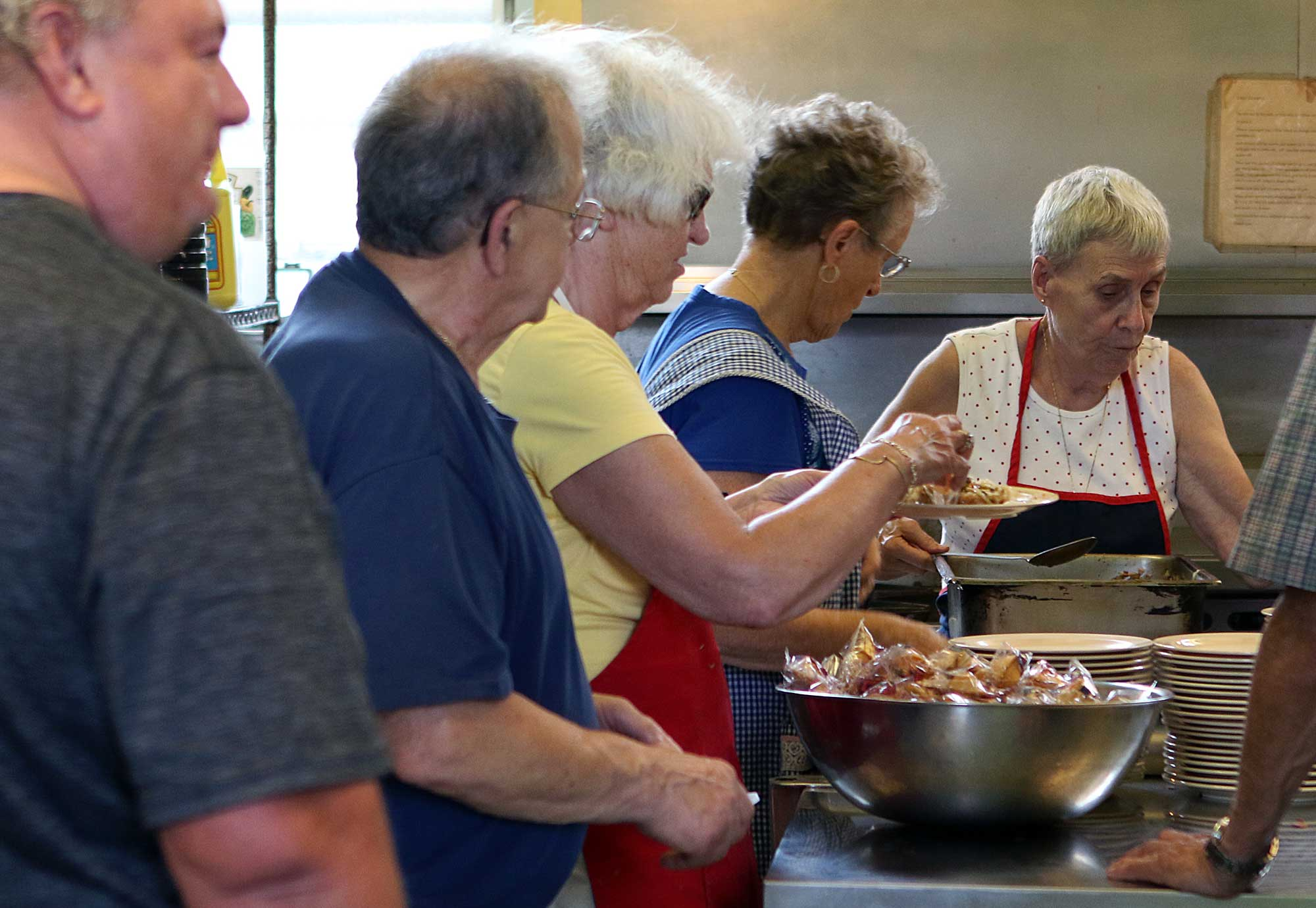 people helping with community meals