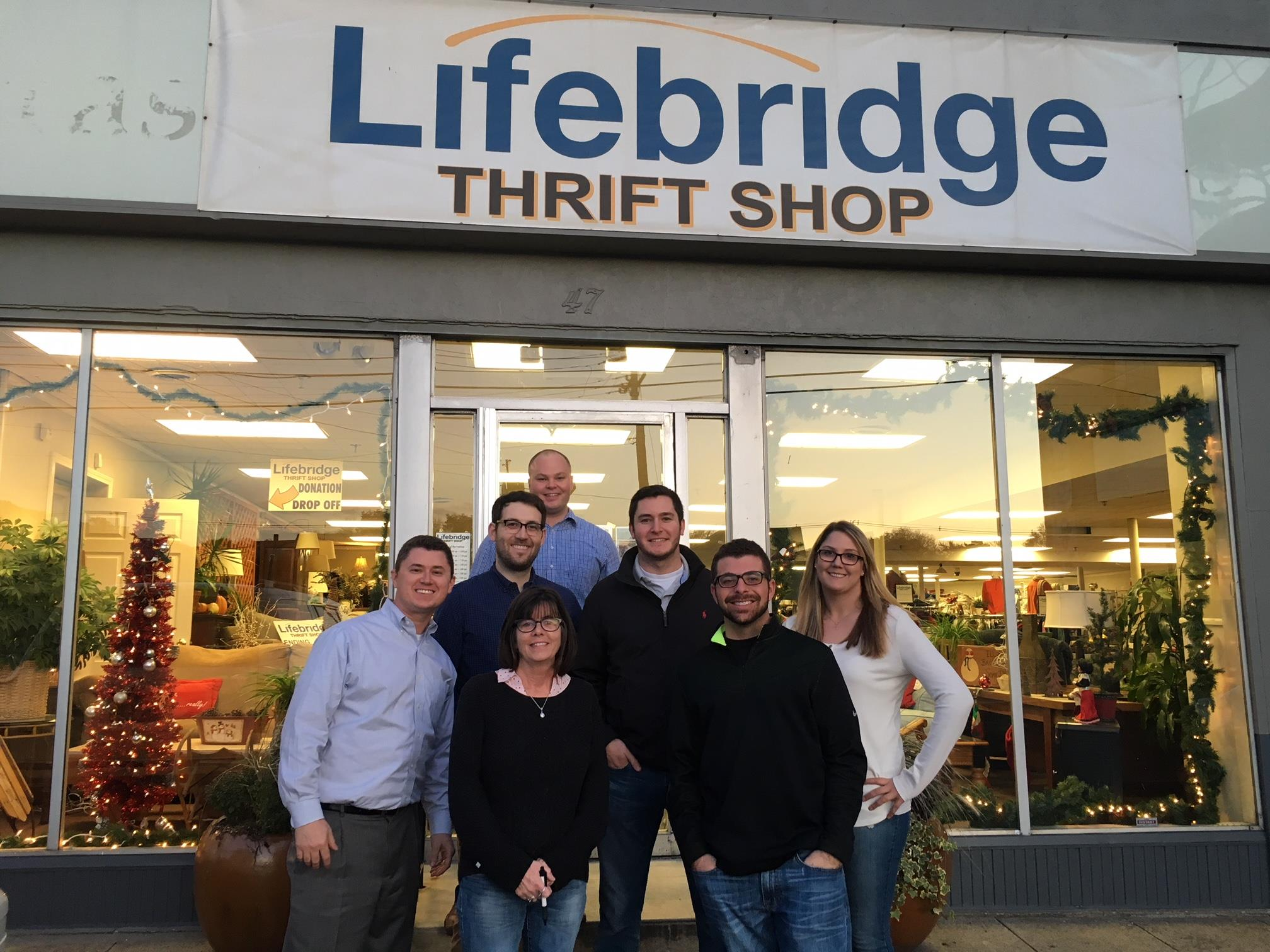 People standing in front of Lifebridge Thrift Shop in Salem, MA