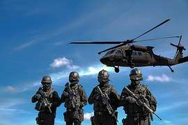 Army soldiers watching a helicopter