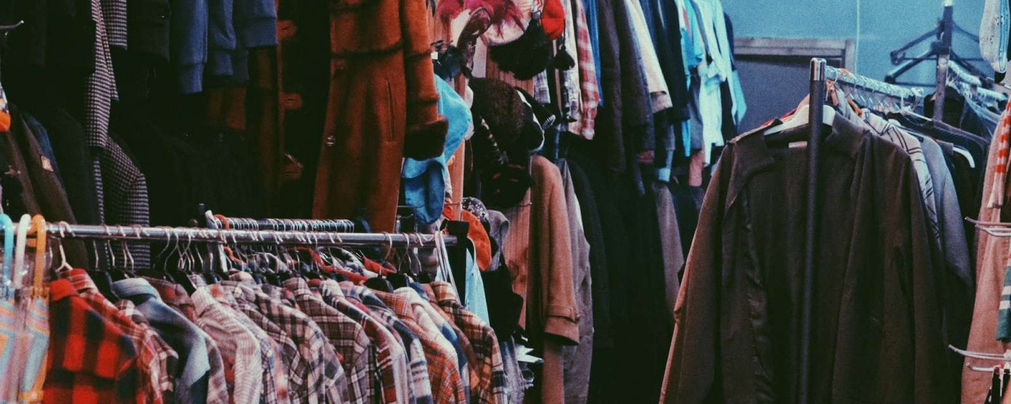 Clothes hanging in a thrift shop