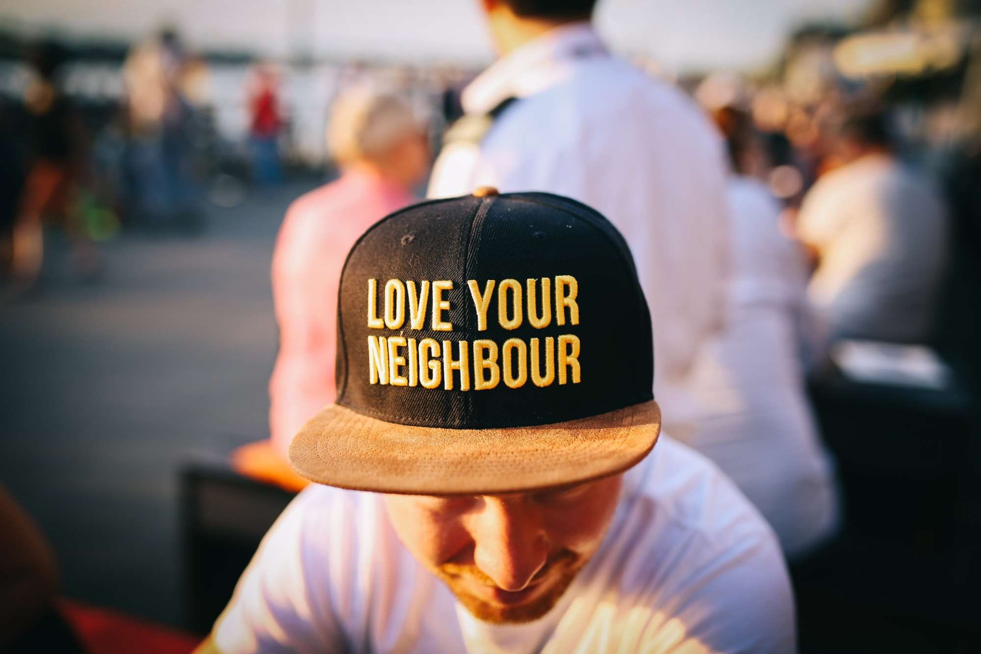 "A hat that says, ""love your neighbor"""