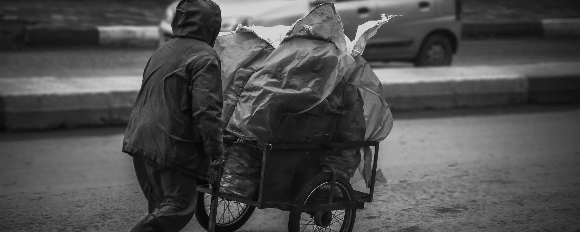 Homeless Man Pushing a Cart