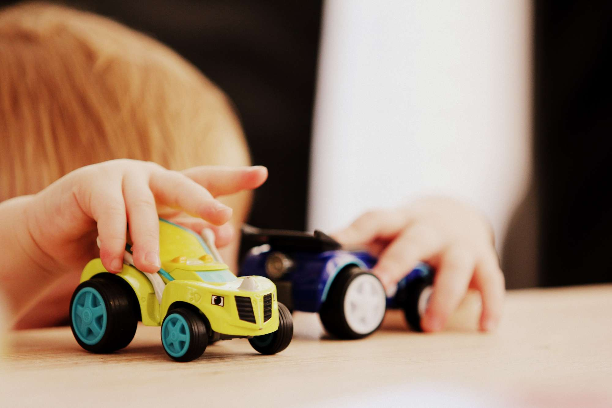 A child playing with toy cars